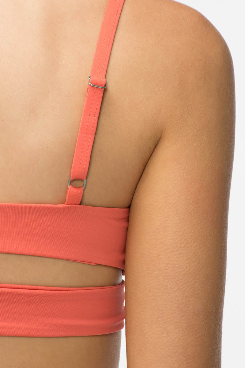 TAVIK Jessi Bikini Top - Coral Bikini Top | Coral| Tavik Jessi Bikini Top Front View - Features: Fixed triangle top Low v neckline Sexy front cut outs Soft & seamless fit Adjustable shoulder straps Dual back bands with metal sliders