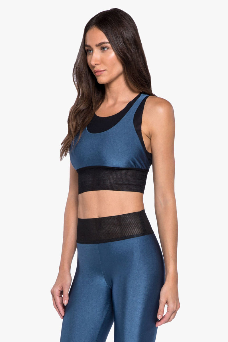 "KORAL Utopia Double Layer Sports Bra - Catalina Activewear | Catalina| Koral Utopia Double Layer Sports Bra - Catalina. . Features:  Double layer sports bra with mesh underlayer and tonal ""K"" logo heat transfer on back Meant for high performance. Athleisure Machine wash cold, inside out like colors; No bleach; Tumble dry low MADE IN USA   Front View"