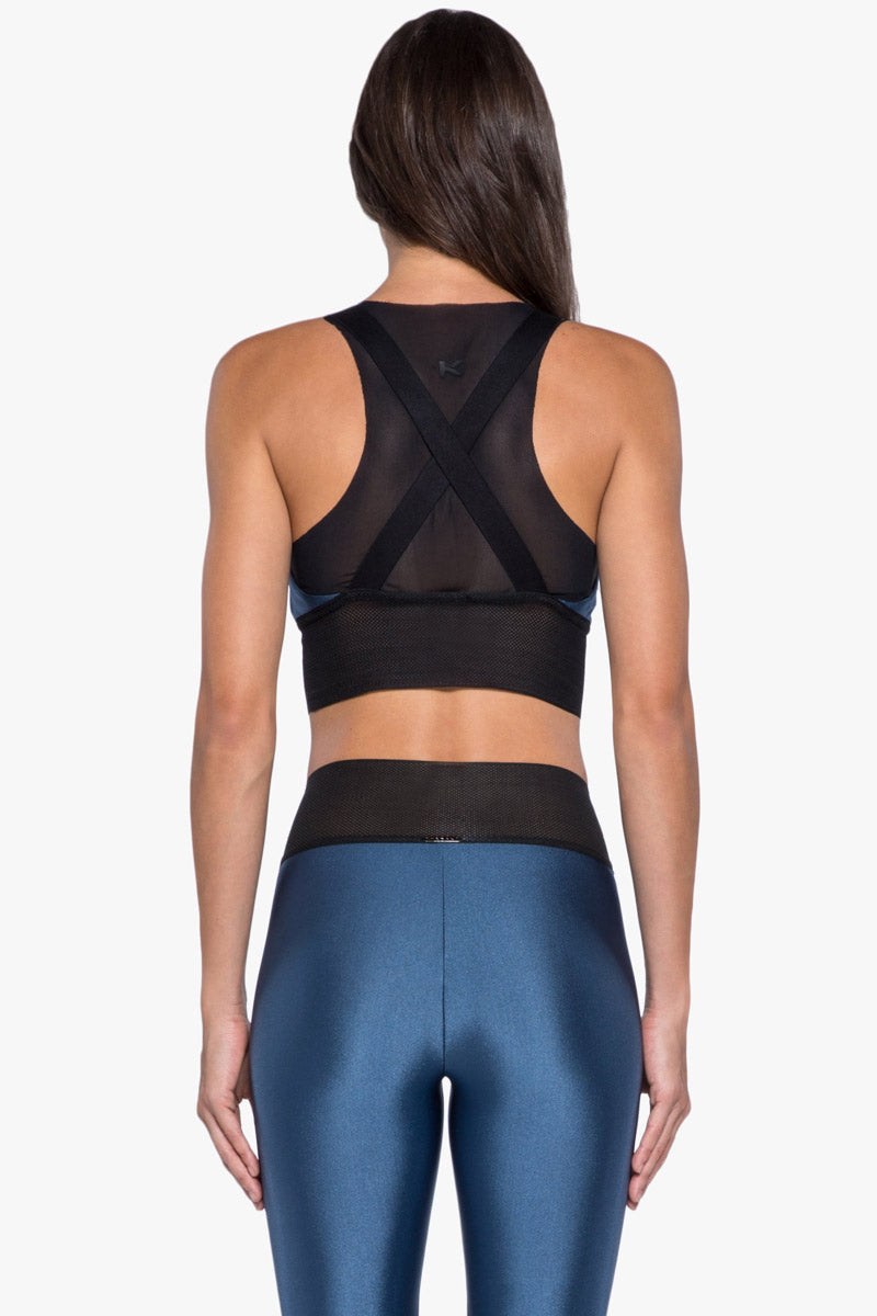"KORAL Utopia Double Layer Sports Bra - Catalina Activewear | Catalina| Koral Utopia Double Layer Sports Bra - Catalina. . Features:  Double layer sports bra with mesh underlayer and tonal ""K"" logo heat transfer on back Meant for high performance. Athleisure Machine wash cold, inside out like colors; No bleach; Tumble dry low MADE IN USA  Back View"