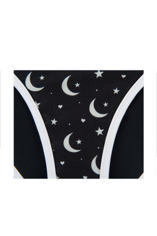 WILDFOX Moon & Star Moderate Bikini Bottom - Black & White Galaxy Print Bikini Bottom | Black & White Galaxy Print | Wildfox Moon & Star Moderate Bikini Bottom - Black & White Galaxy Print Black with white moon and star printed bikini bottoms. Light up the sky in these night sky printed bottoms. Low rise elongates your waist while the moderate Front View