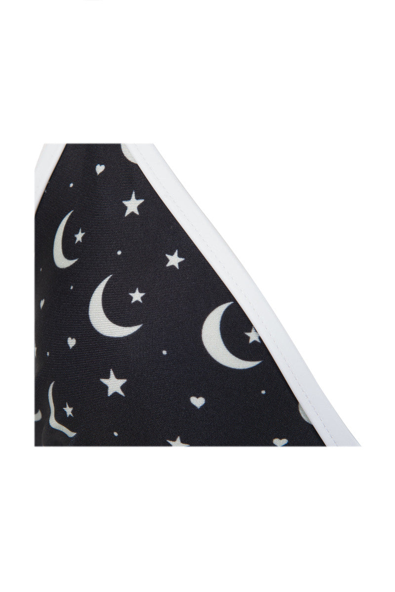 WILDFOX Moon & Star Triangle Bikini Top - Black & White Galaxy Print Bikini Top | Black & White Galaxy Print| Wildfox Moon & Star Triangle Bikini Top - Black & White Galaxy Print Black with white moon and star printed triangle bikini top. Light up the sky in this night sky printed top. Classic triangle cut, bold white trim Adjustable bra-style shoulder straps and back clasp closure Front View