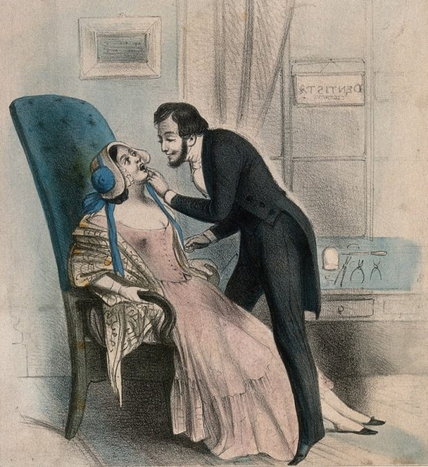 A dentist looking at a tooth of a very attractive female patient 19th century. Coloured lithograph Wellcome Collection. CC BY 4.0 e1537127206360 ba5d3