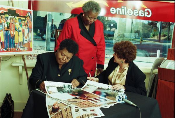 elizabeth eckford and hazel bryan sign posters of their famed picture reconcillation cb09e