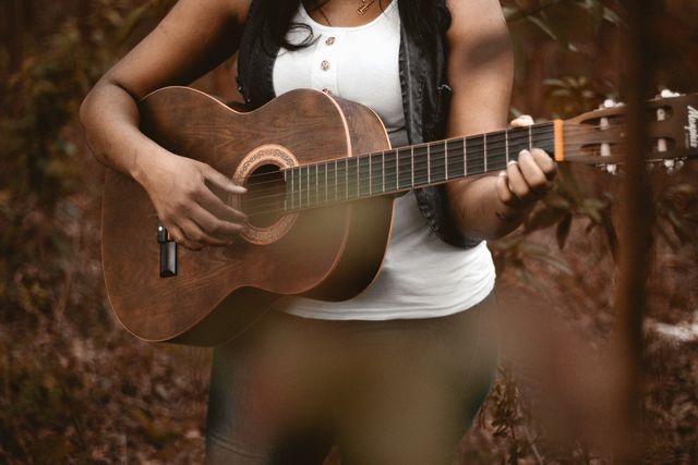 music guitar woman playing musician 1297922.jpgd a0a90