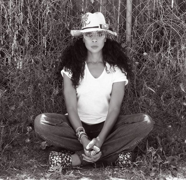 Terry Ellis of En Vogue Sitting Cross-Legged In Black And White