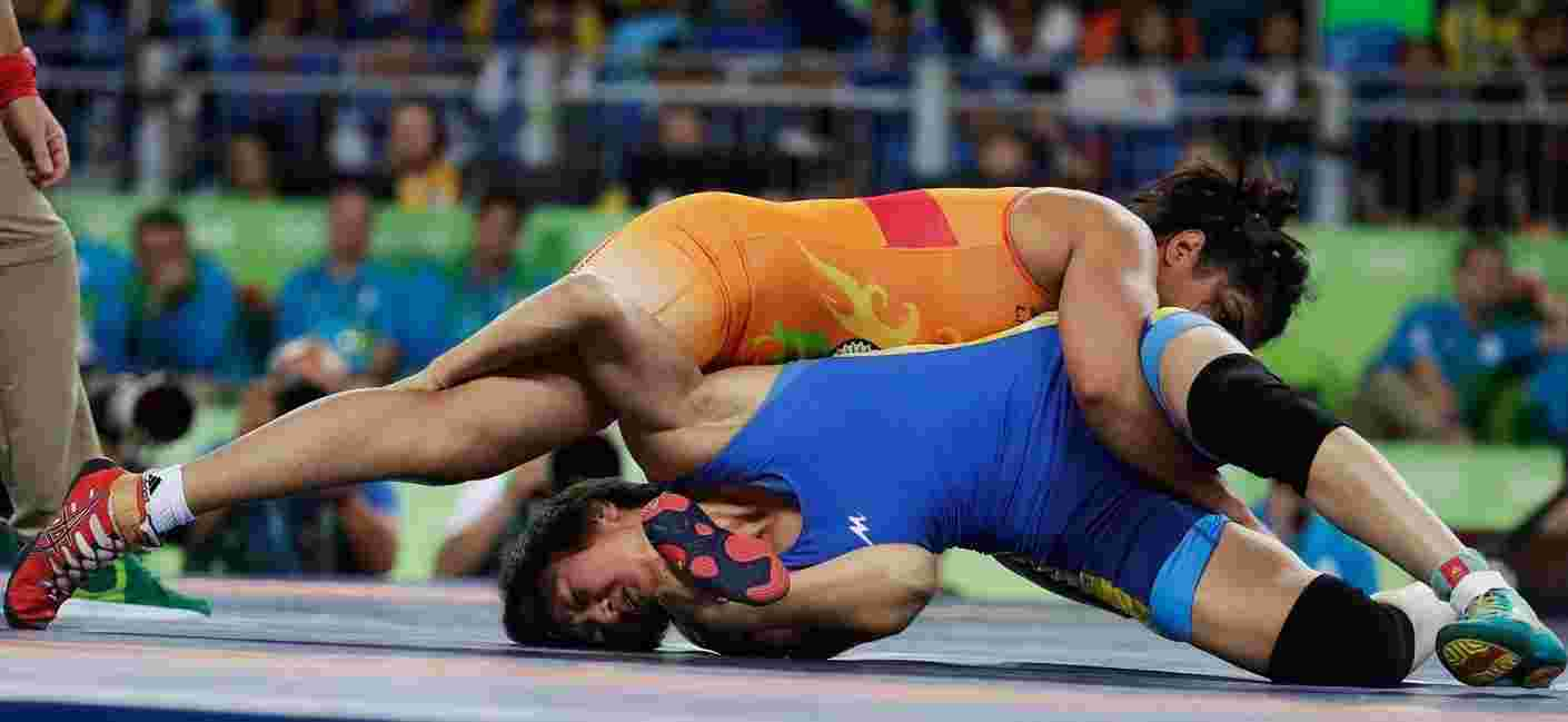 Sakshi Malik (in orange) moments before winning the Bronze medal at 2016 Rio Olympics for Wrestling
