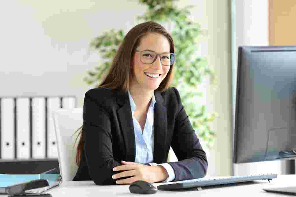 Businesswoman with glasses posing at office