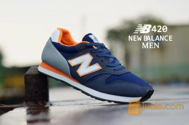 Sepatu olahraga running new balance nb 373 biru navy oren list putih