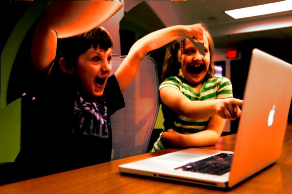 Demonic children wasting their time watching the news
