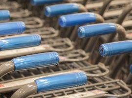 Rows of shopping carts at supermarket entrance