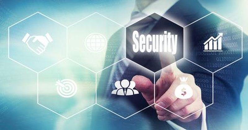 Businessman pressing an Security concept button.