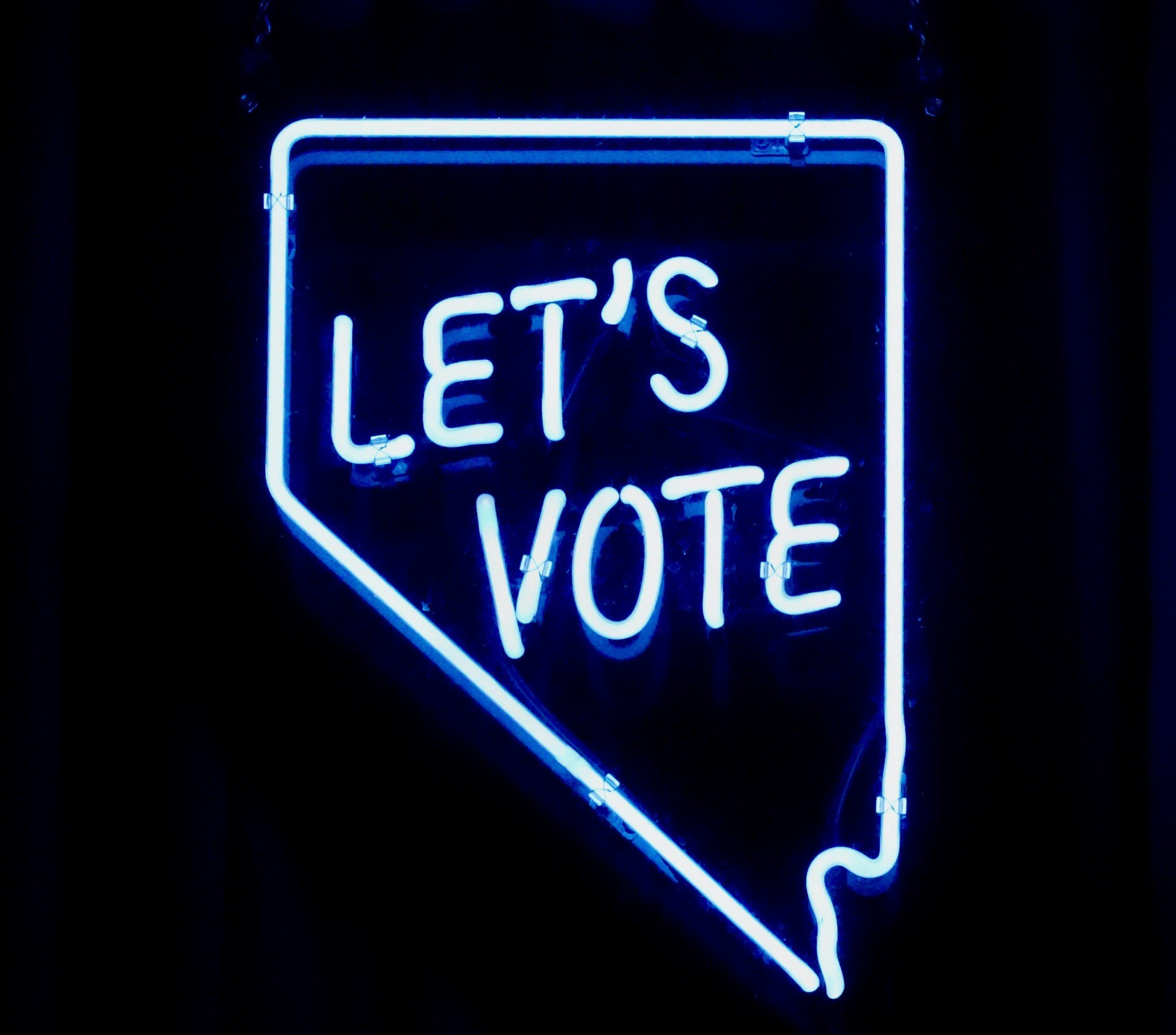 Image showing a neon sign that says Let's Vote