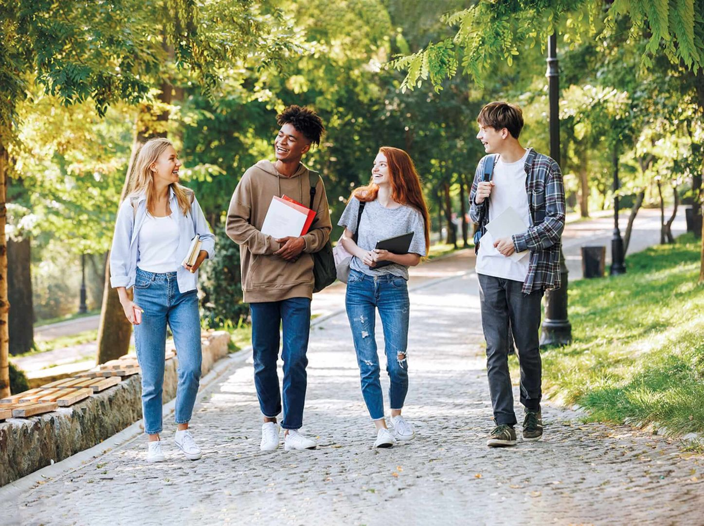 Group of students walking together down a street