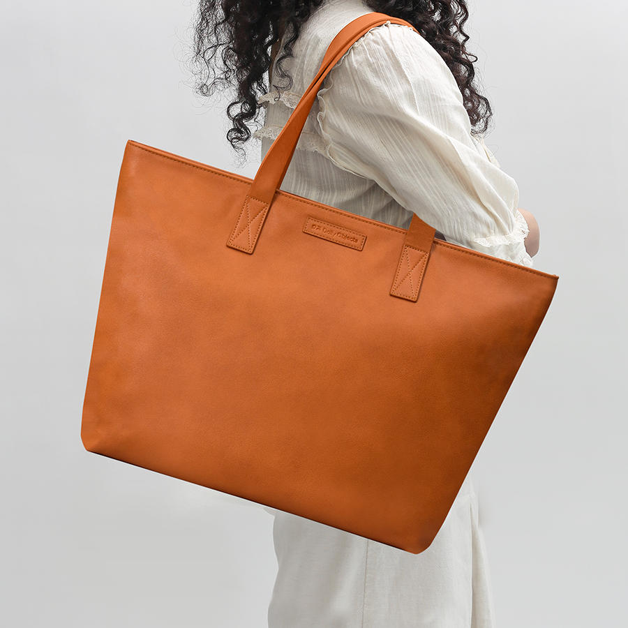 8e11423507c DailyObjects Tan Faux Leather Fatty Tote Bag Buy Online in India ...