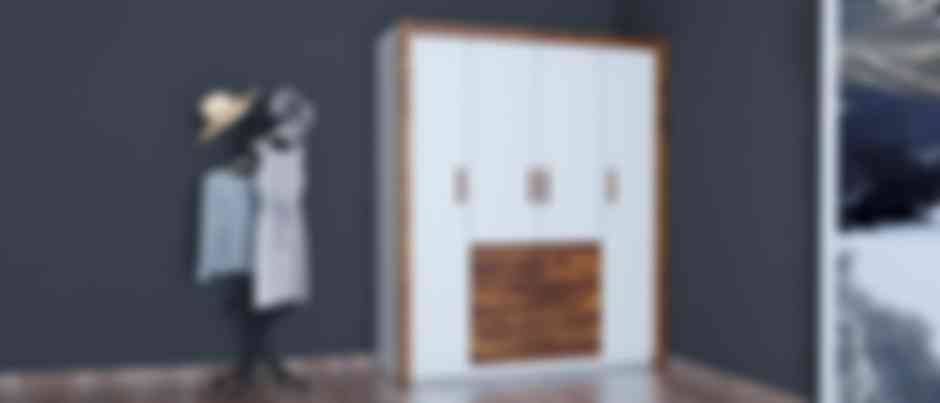 4 door white and brown wardrobe with doors closed in a corner of a room