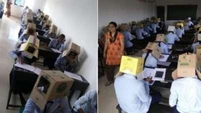 Со картонски кутии на глава, индиски студенти биле спречени да препишуваат на приемен инспит