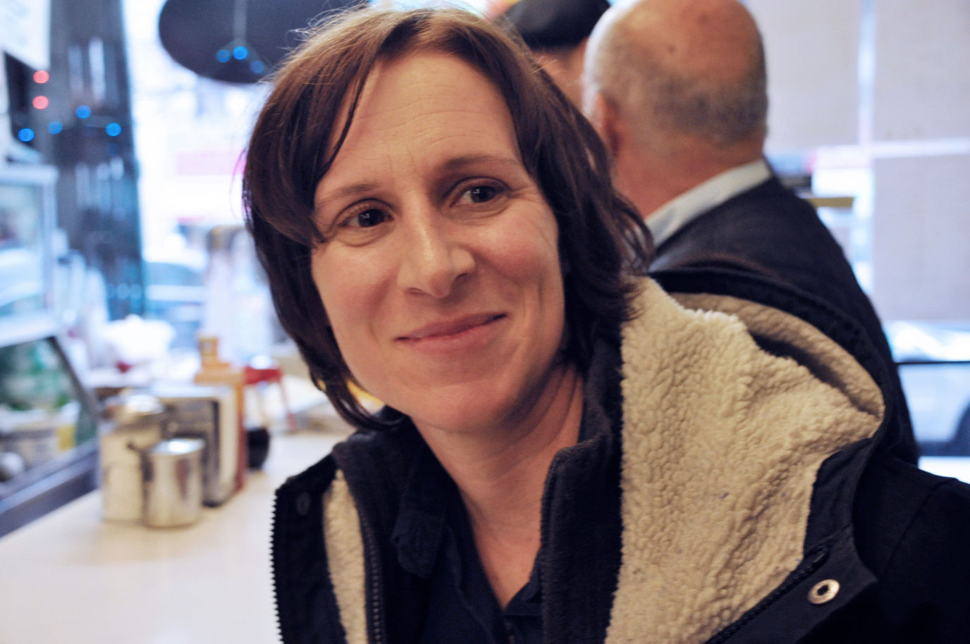 Filmmaker Kelly Reichardt smiling in the camera