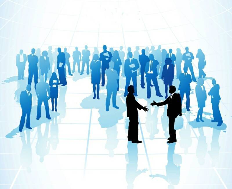 people networking and shaking hands