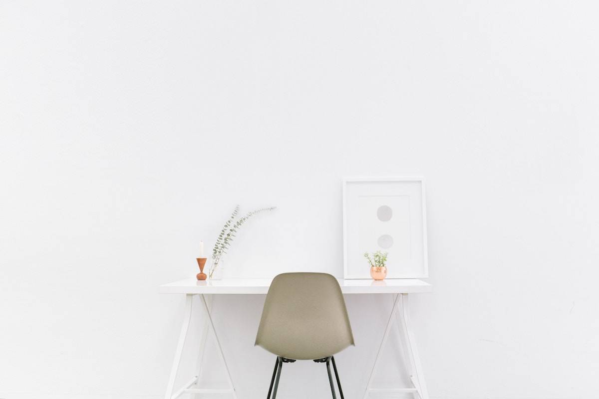declutter your life minimalist chair and desk in a room