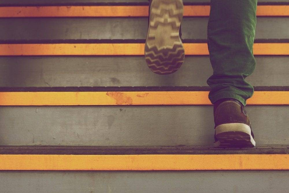marketing workflow without wearing yourself out man walking up the steps