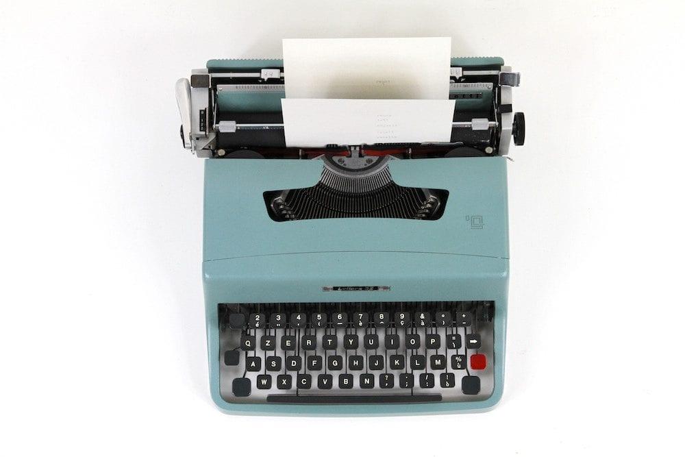 blue typewriter website copy writing tips