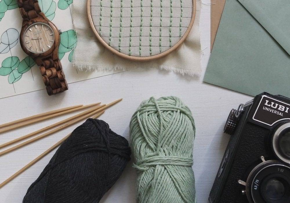 unique hobbies indoor and outdoor - a collection of items like knitting yarn envelope camera and more