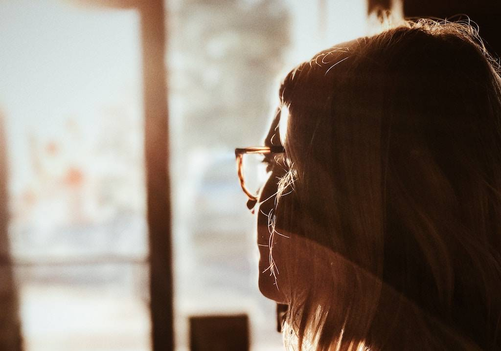 Overcoming Limiting Beliefs - woman gazing out the window