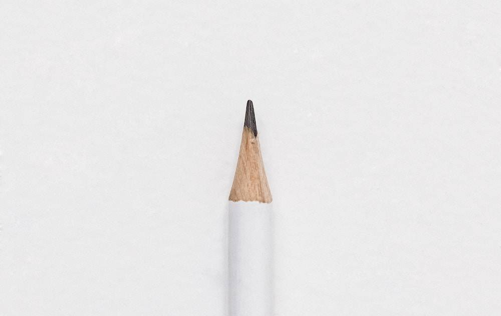 ow to choose word of the year - pencil on a white background