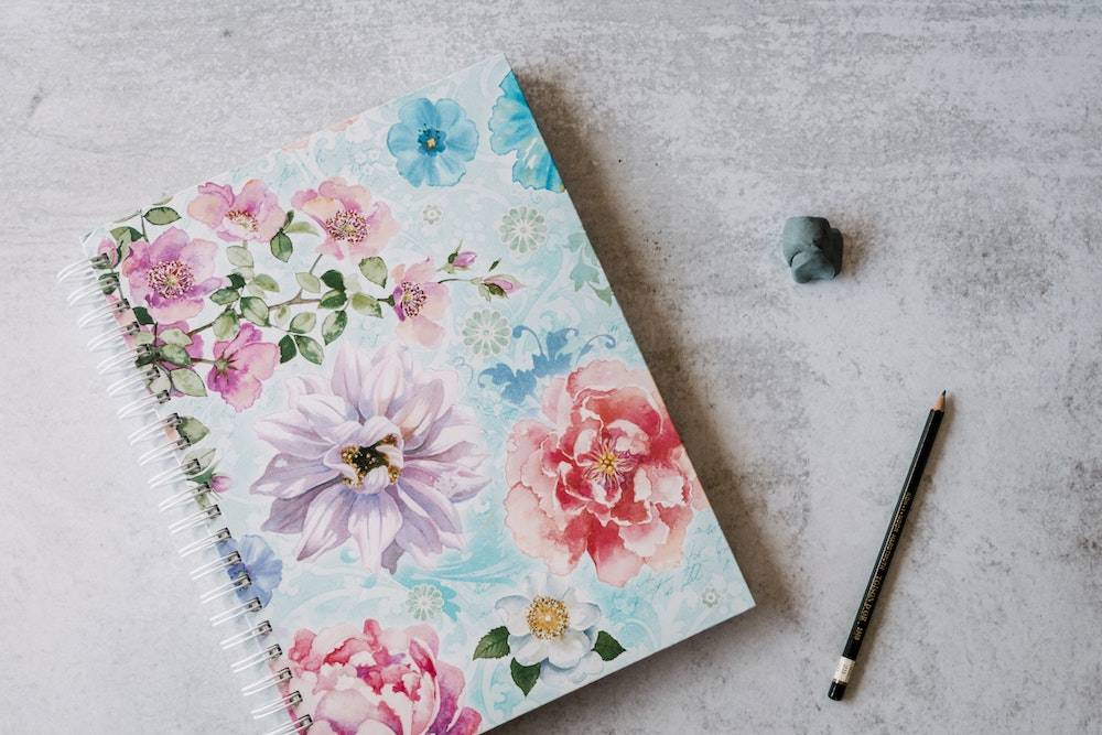 personal inventory a floral patterned notebook with pencil