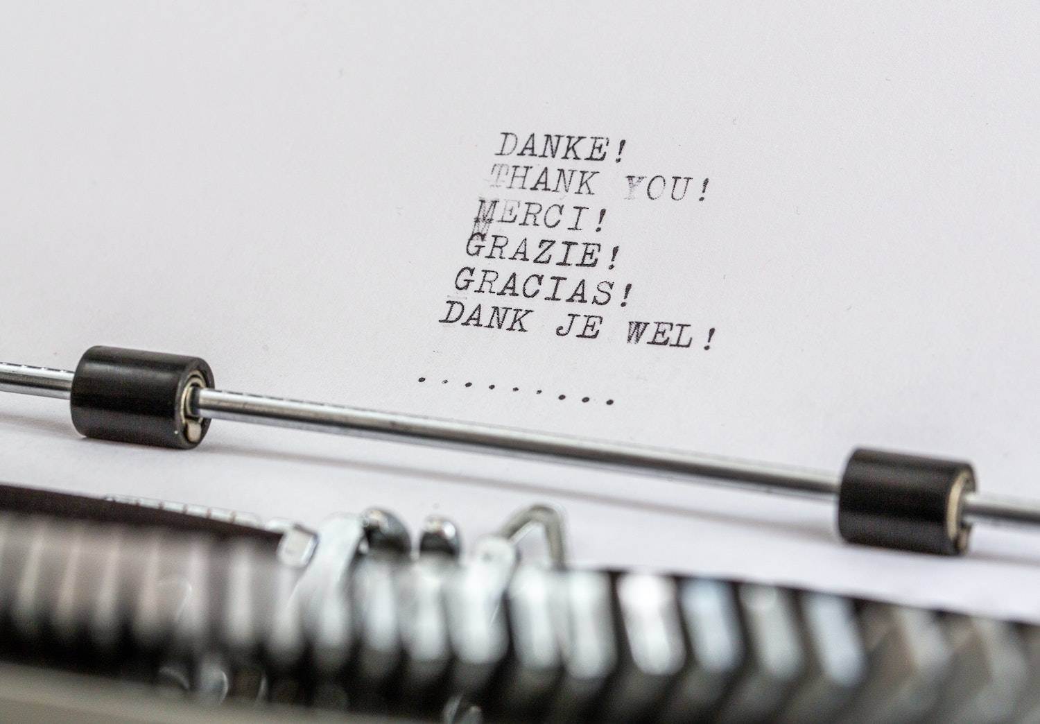 """The Thank You List: a typewriter with the words for """"thank you"""" on the page in six languages"""
