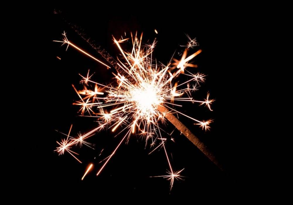 Website Discovery Questions: a handheld sparkler glowing in the dark