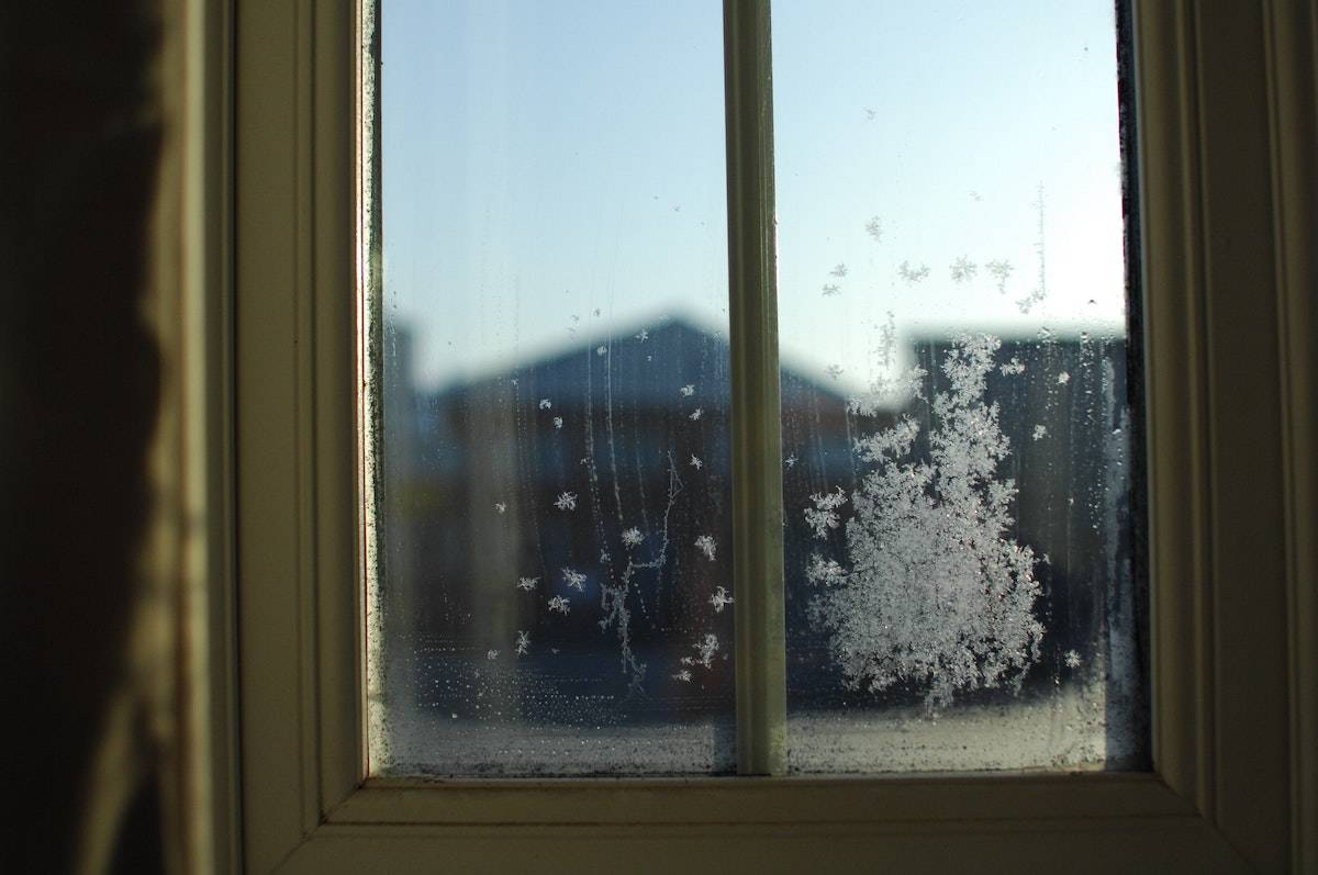 Indoor Winter Activities for Adults: frost on a window pane in winter