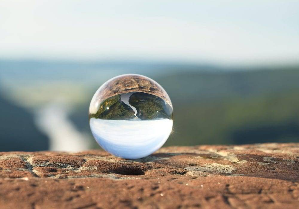 what to do if someone doesn't reply to your email: crystal ball sitting on the edge of a cliff