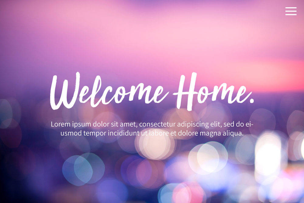 a screenshot of a website that says Welcome Home with a blurred lights photo in the background
