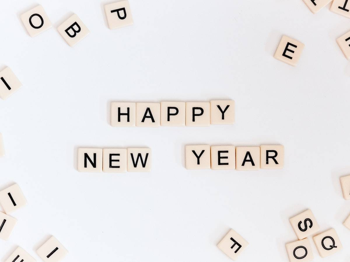 2021 Web Design Trends: scrabble letters on a top spelling out happy new year