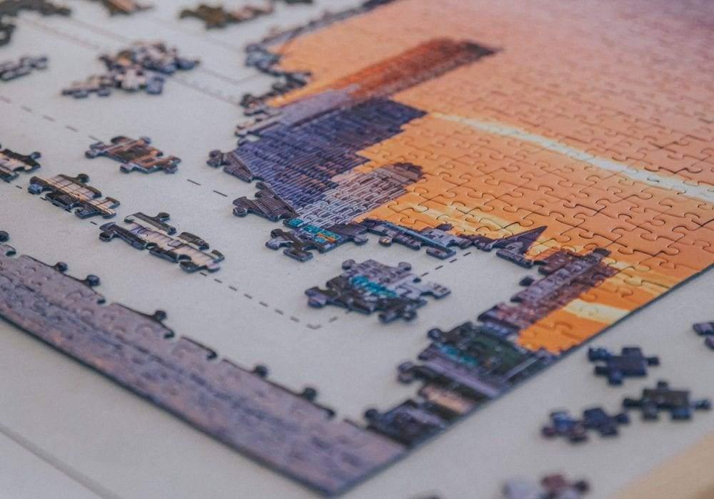 benefits of doing jigsaw puzzles: the corner of a jigsaw puzzle in progress