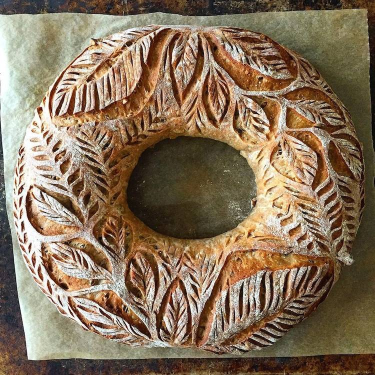 how to stay creative: a round loaf of bread with beautiful ornate carvings in the crust