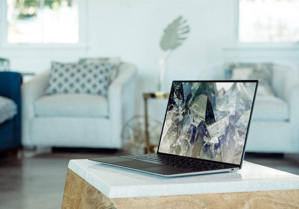 laptop with beautiful desktop image sitting on a coffee table