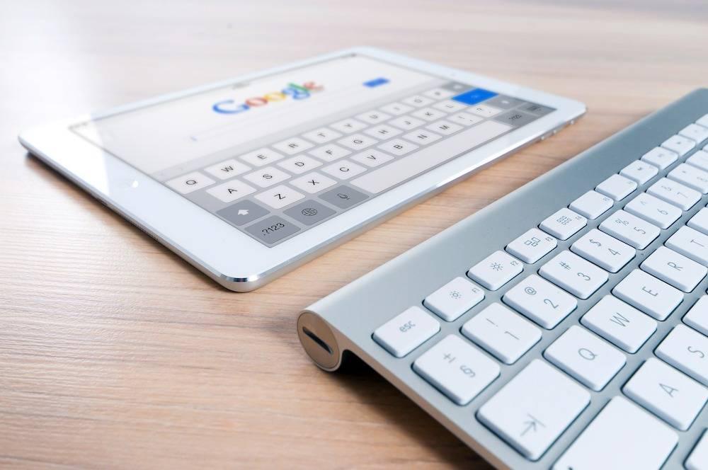 Benefits of WordPress - a keyboard with screen at Google