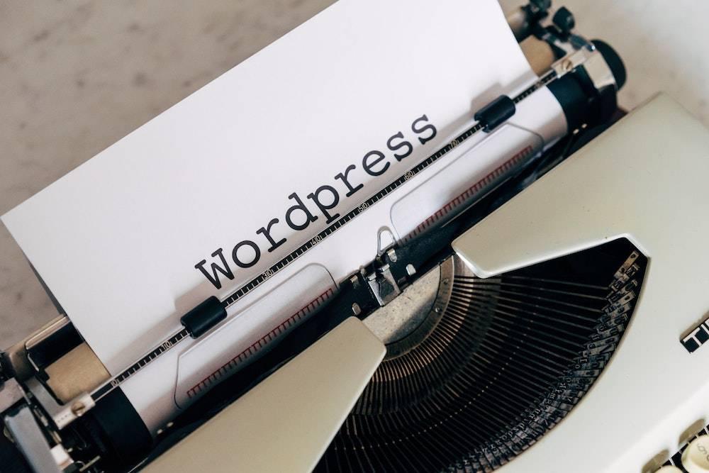 Benefits of WordPress - a typewriter typing out the word WordPress