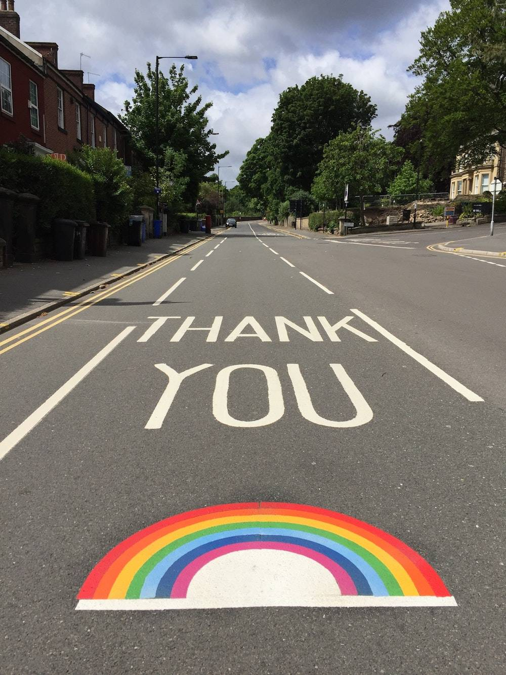 creative ways to say thank you - rainbow painted in the road with thank you in big letters