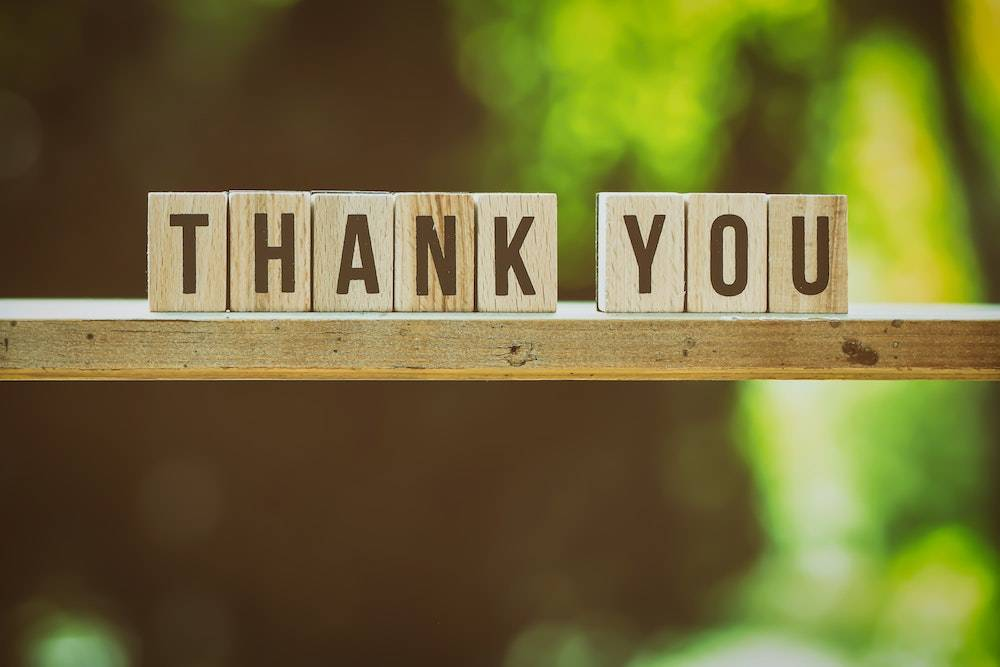 creative ways to say thank you - blocks outdoors on a sunny day that spell thank you