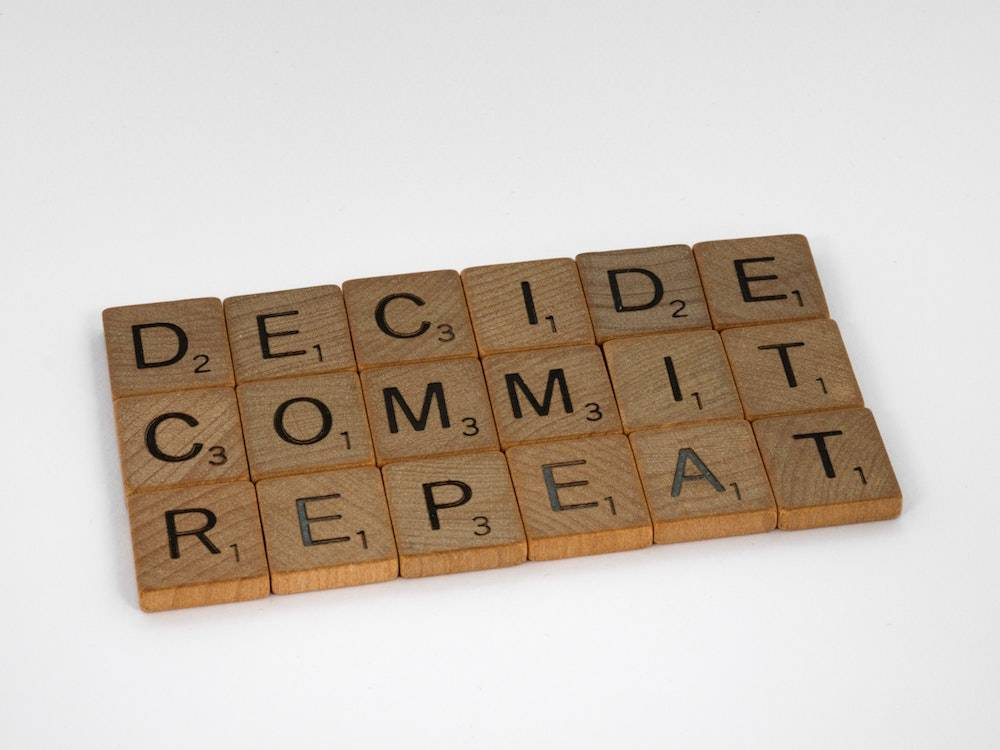 Should I do it yes or no - scrabble tiles that spell decide commit repeat