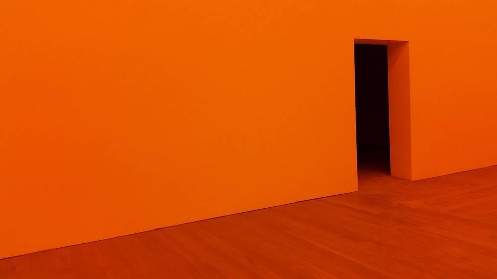 an orange room with doorway