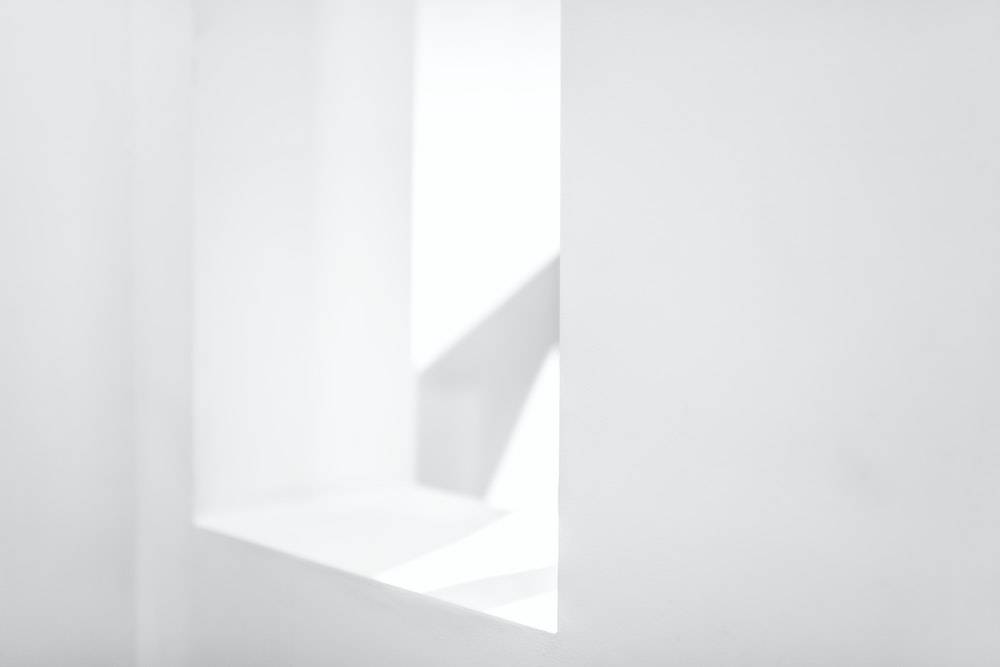 white window in a white room