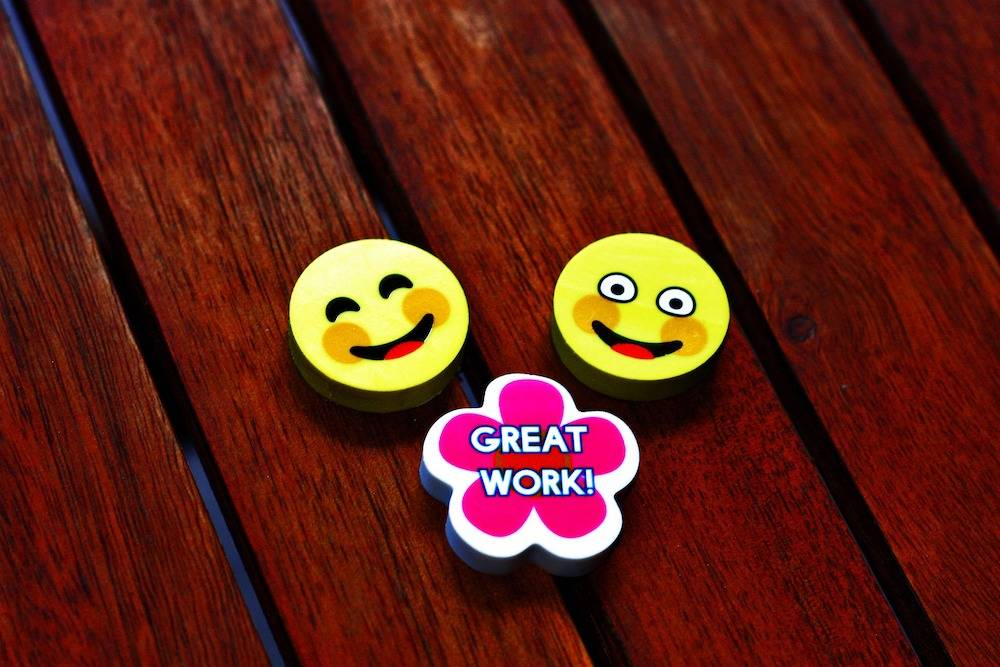 great professional relationship - two smiley face stickers on a table