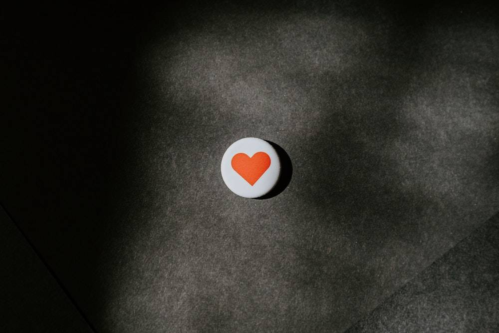 a single button with a heart on it