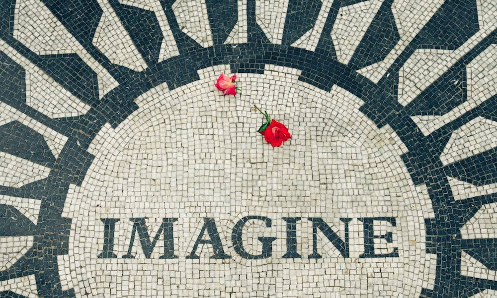mosaic tiles that says imagine with roses