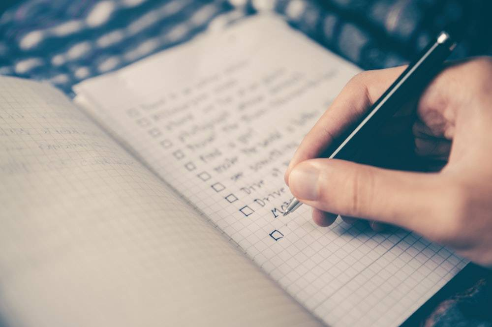Business weekly to do list - a person making a list