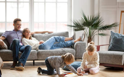 living room with family and kids playing